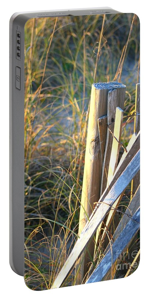 Post Portable Battery Charger featuring the photograph Wooden Post And Fence At The Beach by Nadine Rippelmeyer