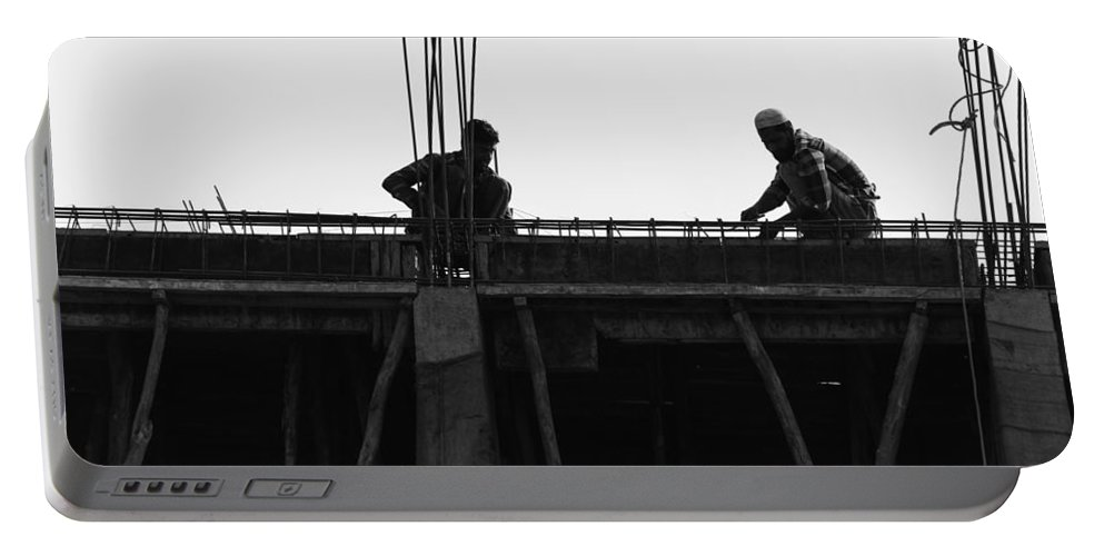 2 Workers Portable Battery Charger featuring the photograph Workers Preparing Iron Girders As Part Of Laying The Roof by Ashish Agarwal