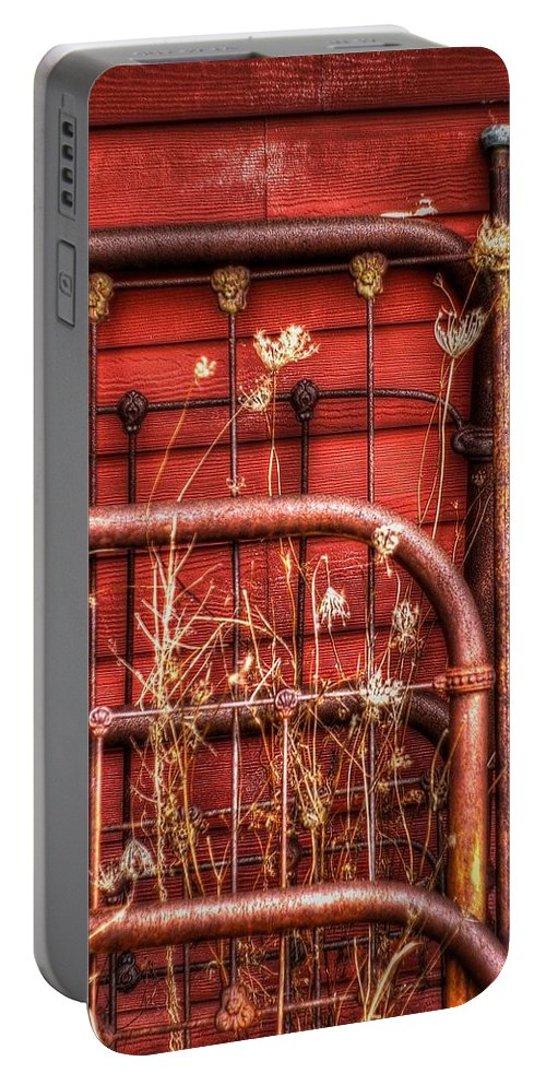 Headboard Portable Battery Charger featuring the photograph Works Of Iron by Randy Pollard
