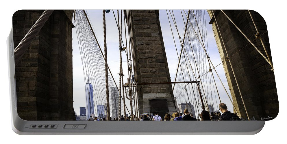 World Trade Center Portable Battery Charger featuring the photograph World Trade Center Through The Bridge by Madeline Ellis
