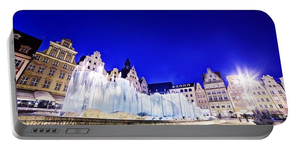 Wroclaw Portable Battery Charger featuring the photograph Wroclaw Poland The Market Square And The Famous Fountain At Night by Michal Bednarek