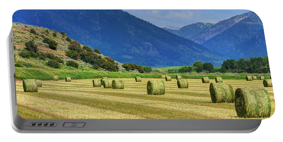 Wyoming Portable Battery Charger featuring the photograph Wyoming Mountain Hay Farm by Gary Whitton