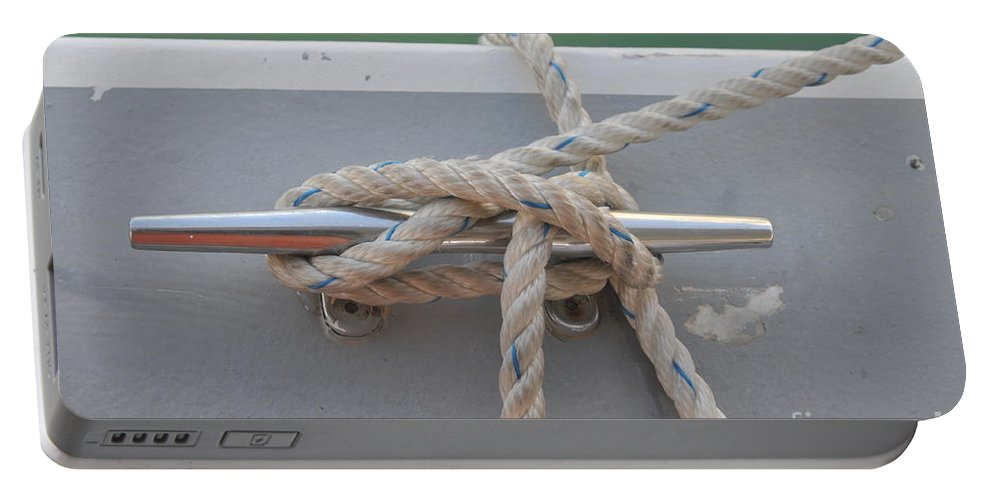 Yacht Portable Battery Charger featuring the photograph Yacht Secured To A Jetty by Shay Levy