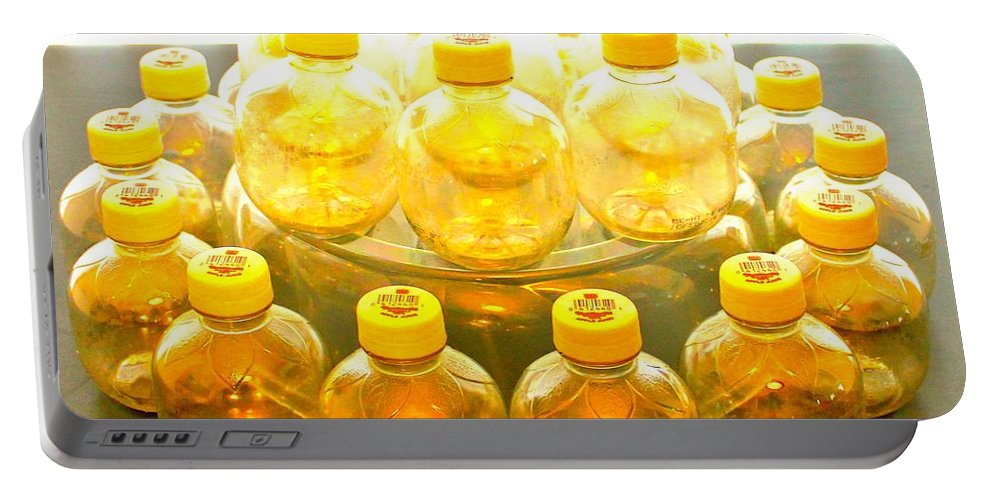 Still Life Portable Battery Charger featuring the photograph Yellow Bottle by Lorna Maza