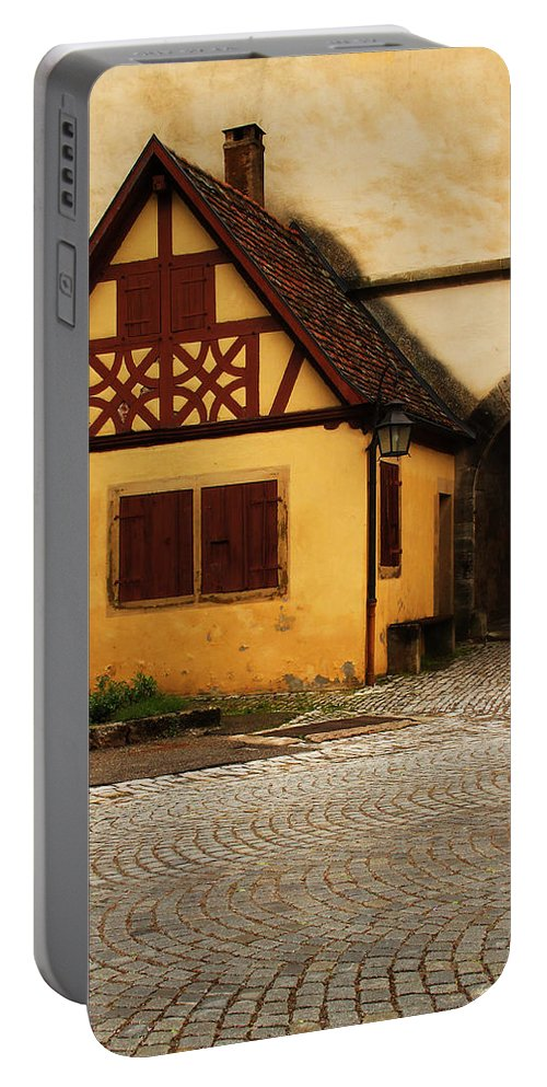 Rothenburg Portable Battery Charger featuring the photograph Yellow Building And Wall In Rothenburg Germany by Greg Matchick