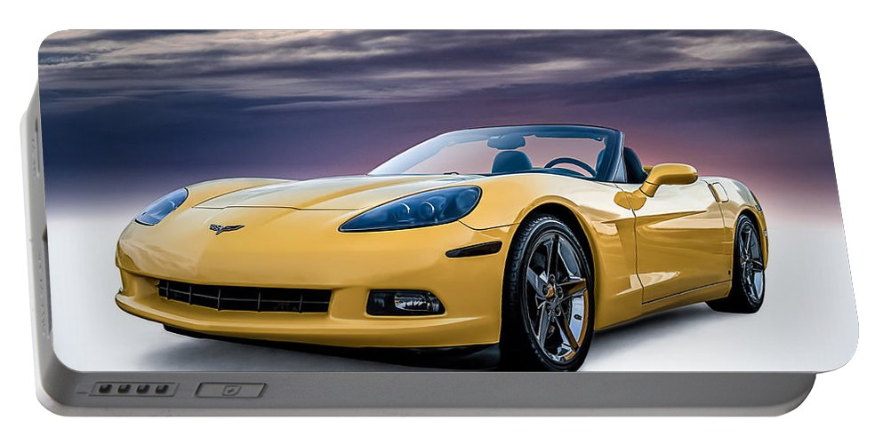 Yellow Portable Battery Charger featuring the digital art Yellow Corvette Convertible by Douglas Pittman