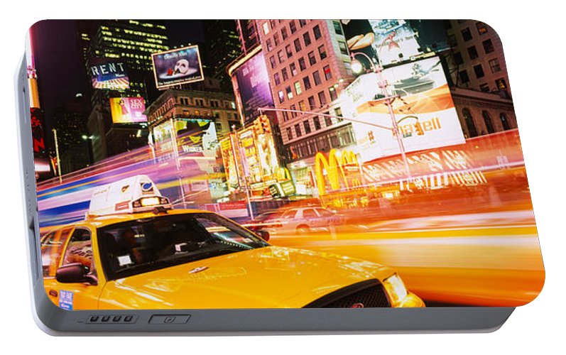 Photography Portable Battery Charger featuring the photograph Yellow Taxi On The Road, Times Square by Panoramic Images
