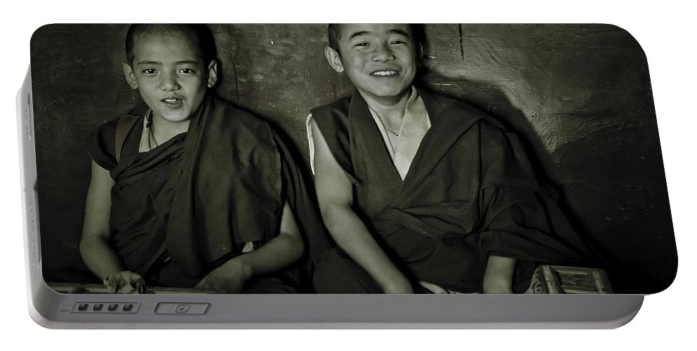 Valerie Rosen Portable Battery Charger featuring the photograph Young Buddhist Monks by Valerie Rosen