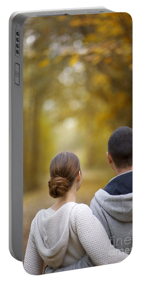 Couple Portable Battery Charger featuring the photograph Young Couple Looking Ahead by Lee Avison