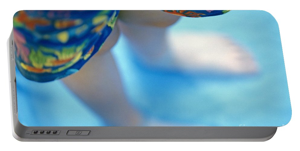 Playfulness Portable Battery Charger featuring the photograph Young Girl Standing In Pool by Jim Corwin