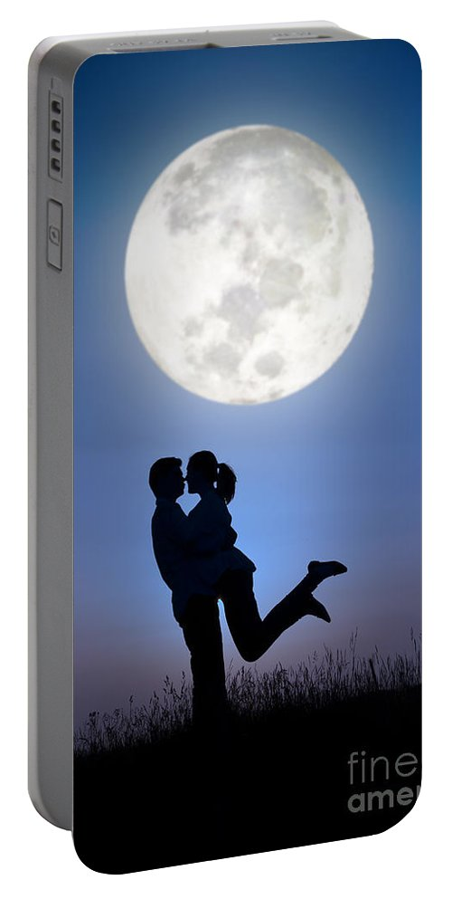 Couple Portable Battery Charger featuring the photograph Young Lovers Embracing Before A Full Moon by Lee Avison