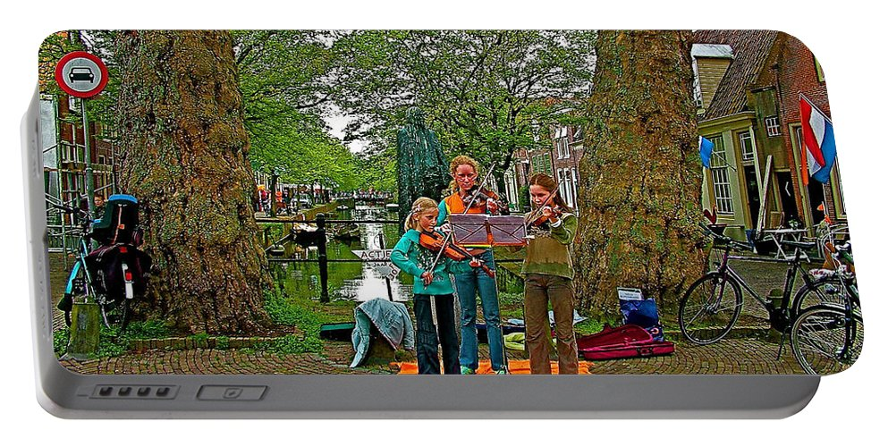 Young Musicians On Orange Day By A Canal In Enkhuizen Portable Battery Charger featuring the photograph Young Musicians On Orange Day By A Canal In Enkhuizen-netherland by Ruth Hager