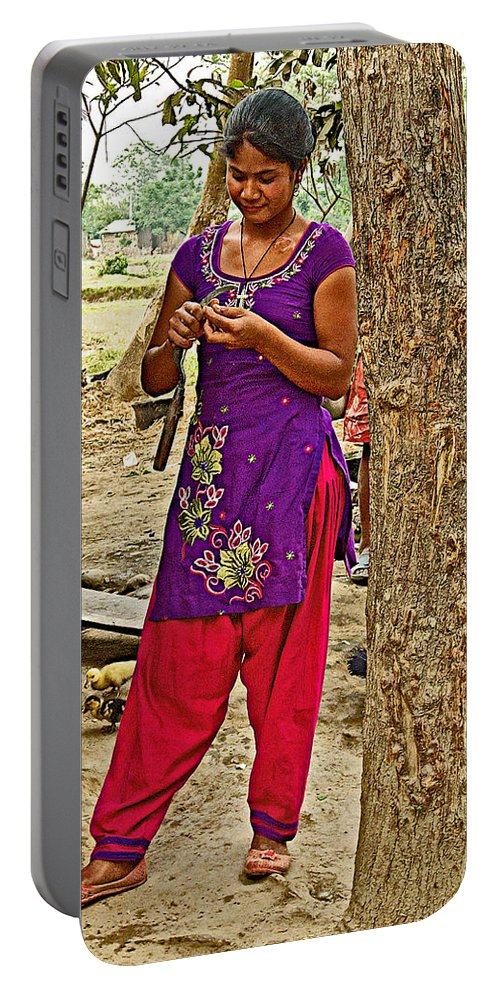 Young Tharu Village Woman In Traditional Nepali Clothing In Tharu Village In Nepal Portable Battery Charger featuring the photograph Young Tharu Village Woman In Traditional Nepali Clothing-nepal by Ruth Hager