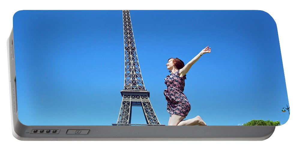 Eiffel Portable Battery Charger featuring the photograph Young Woman Jumping Against Eiffel Tower by Michal Bednarek