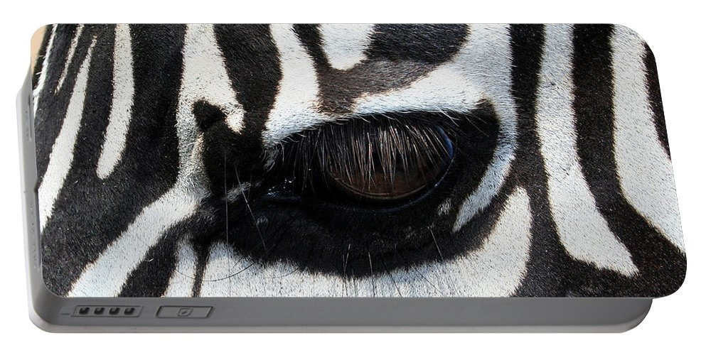 Zebra Portable Battery Charger featuring the photograph Zebra Eye by Linda Sannuti