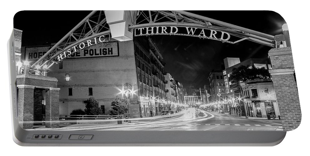 Black & White Portable Battery Charger featuring the photograph Zooming Past Historic Third Ward by Andrew Slater