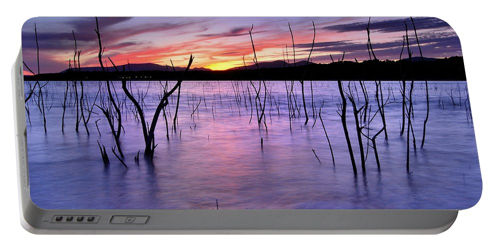 Sunset Portable Battery Charger featuring the photograph Purple Lake by Guido Montanes Castillo