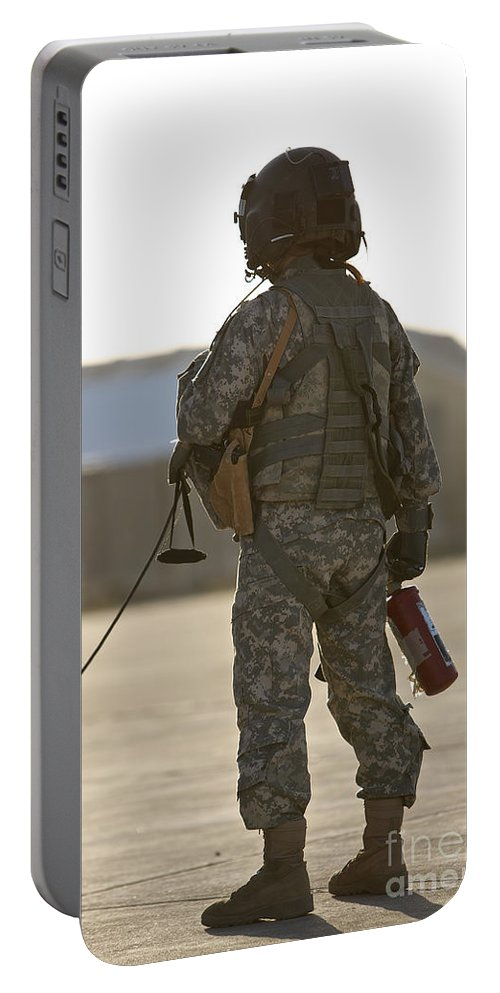 Aviation Portable Battery Charger featuring the photograph A Flight Crew Member Stands by Terry Moore