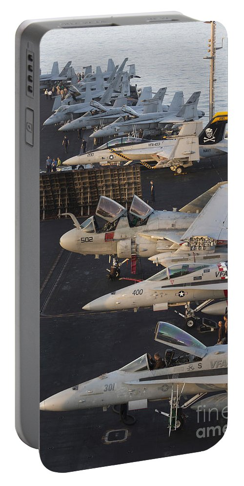 Arabian Sea Portable Battery Charger featuring the photograph Aircraft Parked On The Flight Deck by Gert Kromhout