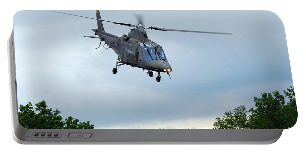 Helicopter Portable Battery Charger featuring the photograph An Agusta A109 Helicopter by Luc De Jaeger