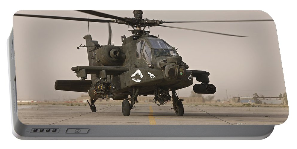 Ah-64 Portable Battery Charger featuring the photograph An Ah-64 Apache Helicopter Taxiing by Terry Moore