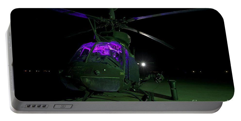Aviation Portable Battery Charger featuring the photograph An Oh-58d Kiowa Helicopter At Cob by Terry Moore