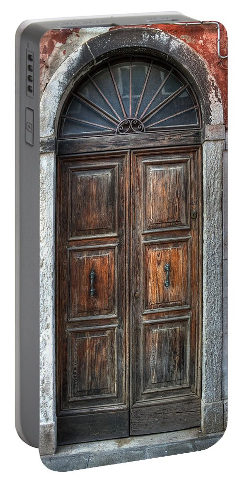 Door Portable Battery Charger featuring the photograph an old wooden door in Italy by Joana Kruse