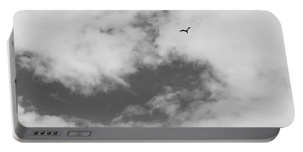 Skies Portable Battery Charger featuring the photograph As Free As A Bird by David Pyatt