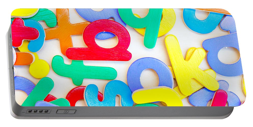 Assortment Portable Battery Charger featuring the photograph Colorful Letters by Tom Gowanlock
