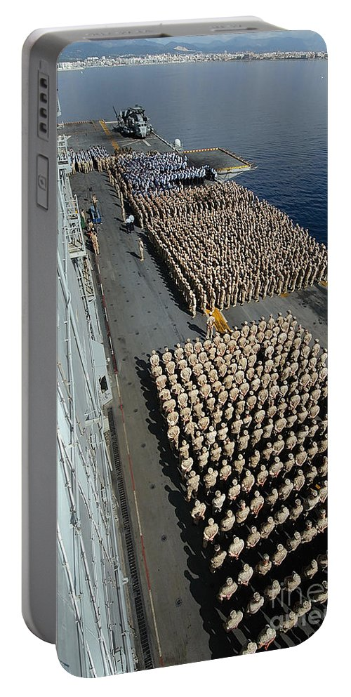 Color Image Portable Battery Charger featuring the photograph Crew Aboard The Amphibious Assault Ship by Stocktrek Images