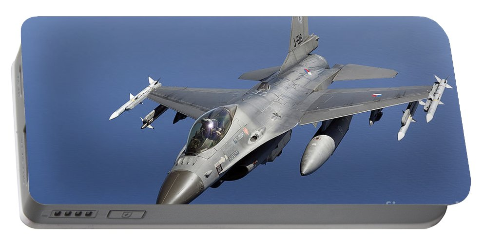 Aim-120 Portable Battery Charger featuring the photograph Dutch F-16am During A Combat Air Patrol by Gert Kromhout