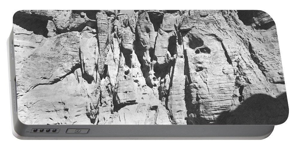 Desert Portable Battery Charger featuring the photograph Eroded Sandstone Cliffs by Frank Wilson