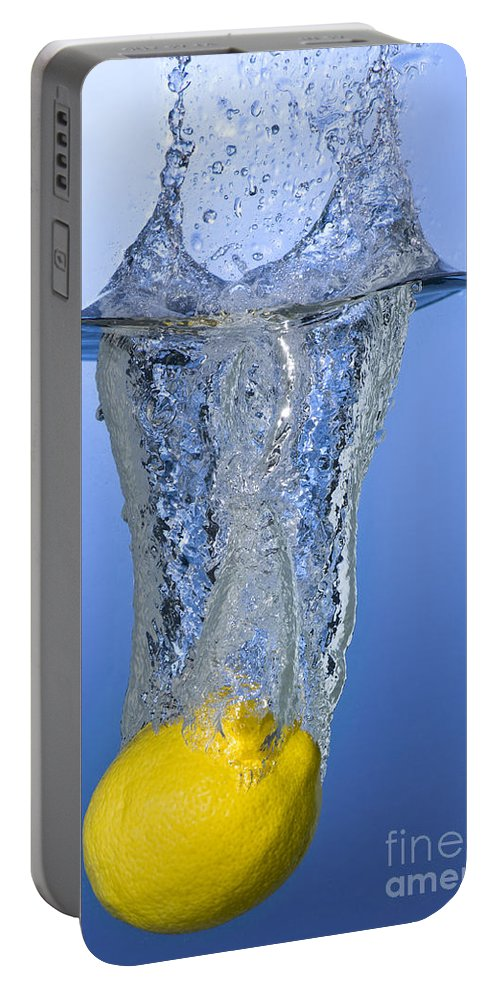 Lemon Portable Battery Charger featuring the photograph Lemon Dropped In Water by Ted Kinsman