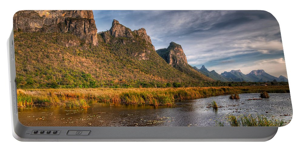 Asia Portable Battery Charger featuring the photograph National Park by Adrian Evans