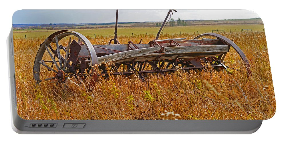 Old Equipment Portable Battery Charger featuring the photograph Old Farm Equipment by Randy Harris