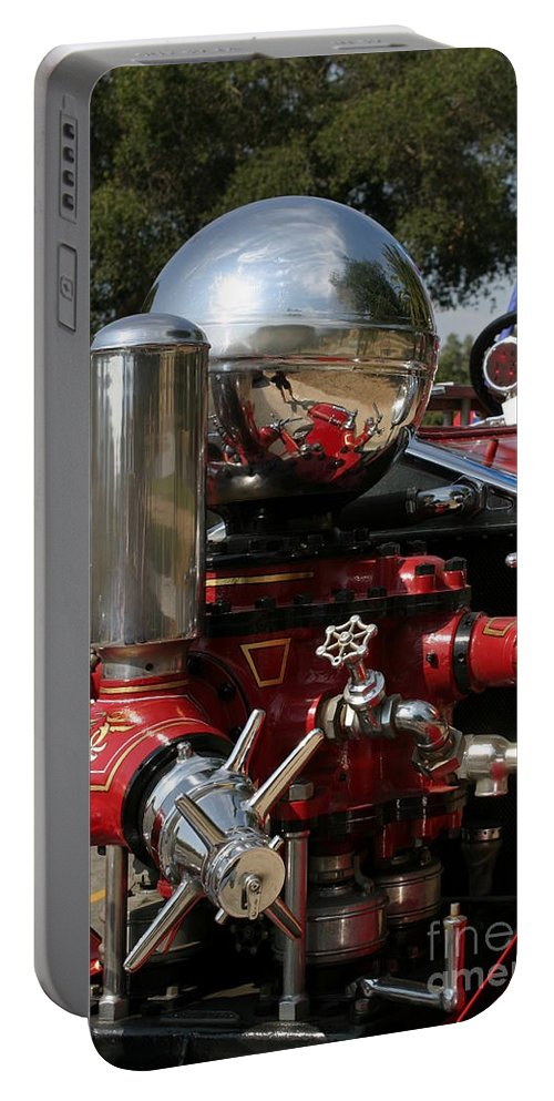 911 Portable Battery Charger featuring the photograph Old Fire Truck by Henrik Lehnerer