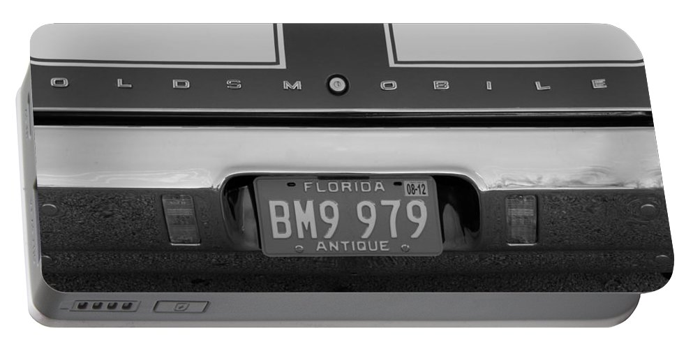 Oldsmobile Portable Battery Charger featuring the photograph Olds Cs In Black And White by Rob Hans