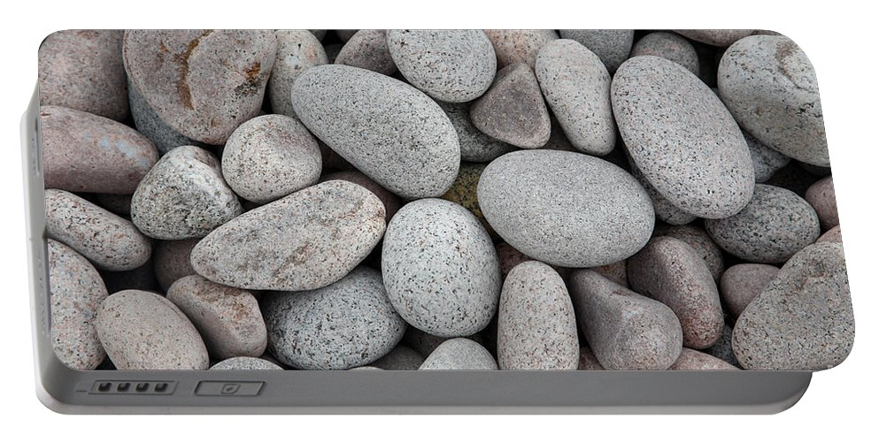 Rock Portable Battery Charger featuring the photograph Pebbles On Beach by Ted Kinsman