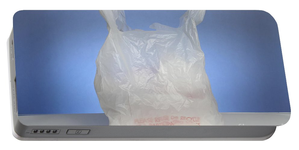 Bag Portable Battery Charger featuring the photograph Plastic Bag by Photo Researchers, Inc.