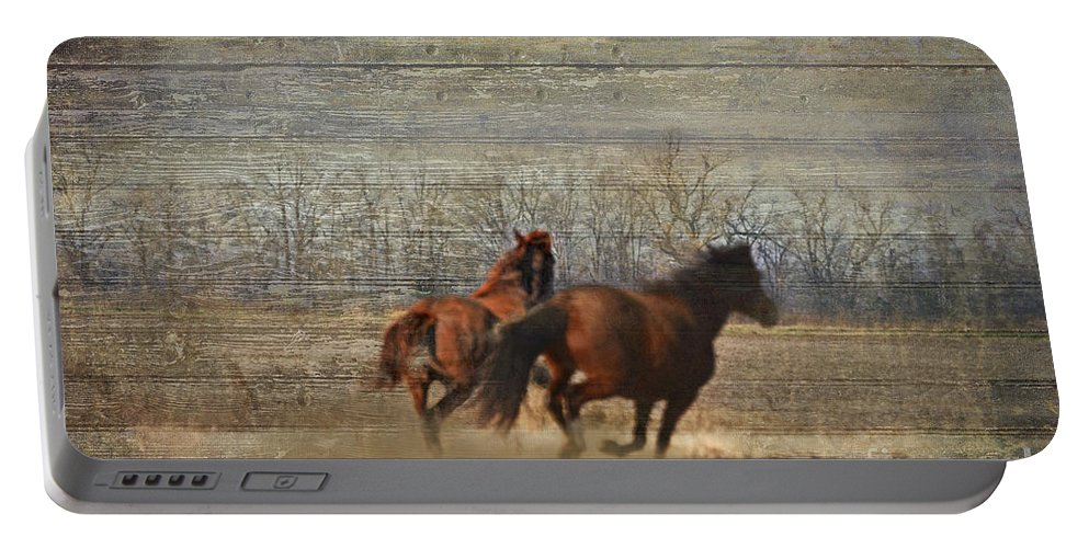 Animals Portable Battery Charger featuring the photograph Running Free by Debbie Portwood