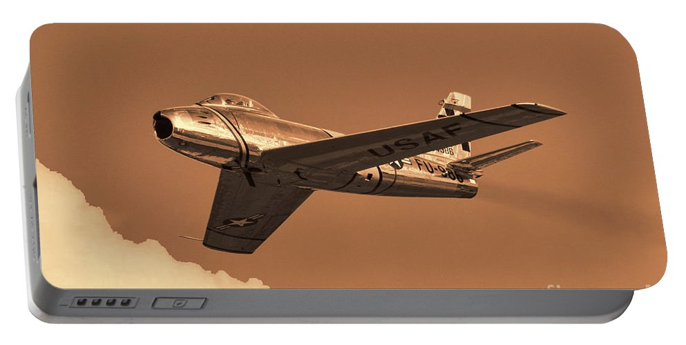 North American F-86 Sabre Portable Battery Charger featuring the photograph Sabre by Tommy Anderson