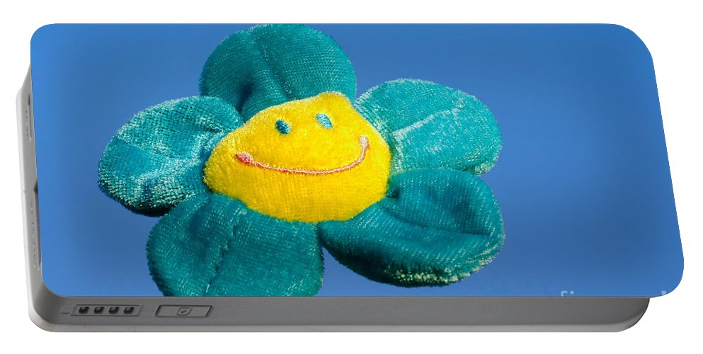 Smile Flower Portable Battery Charger featuring the photograph Smile Flower by Mats Silvan
