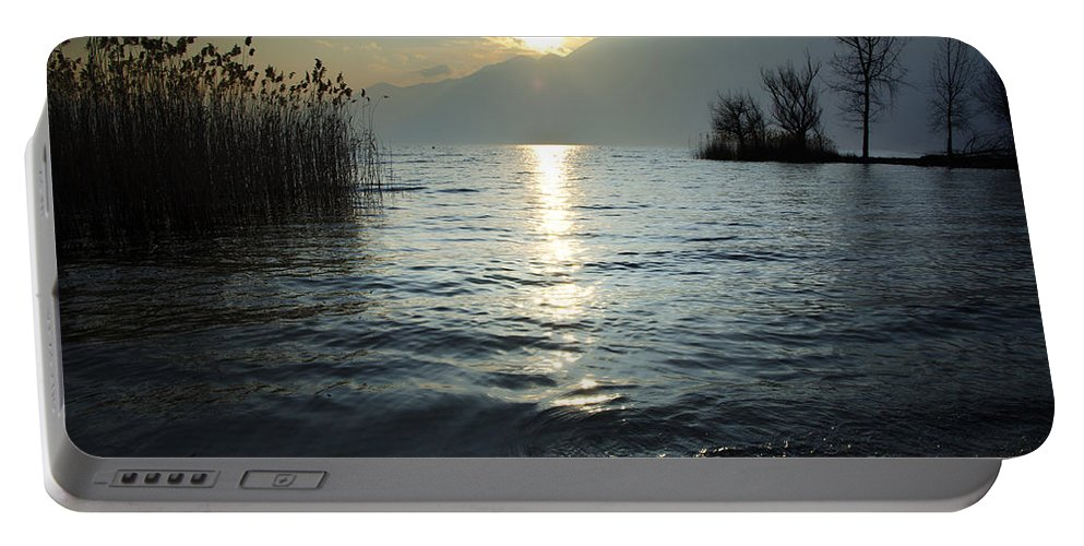 Sunset Portable Battery Charger featuring the photograph Sunset Over An Alpine Lake by Mats Silvan