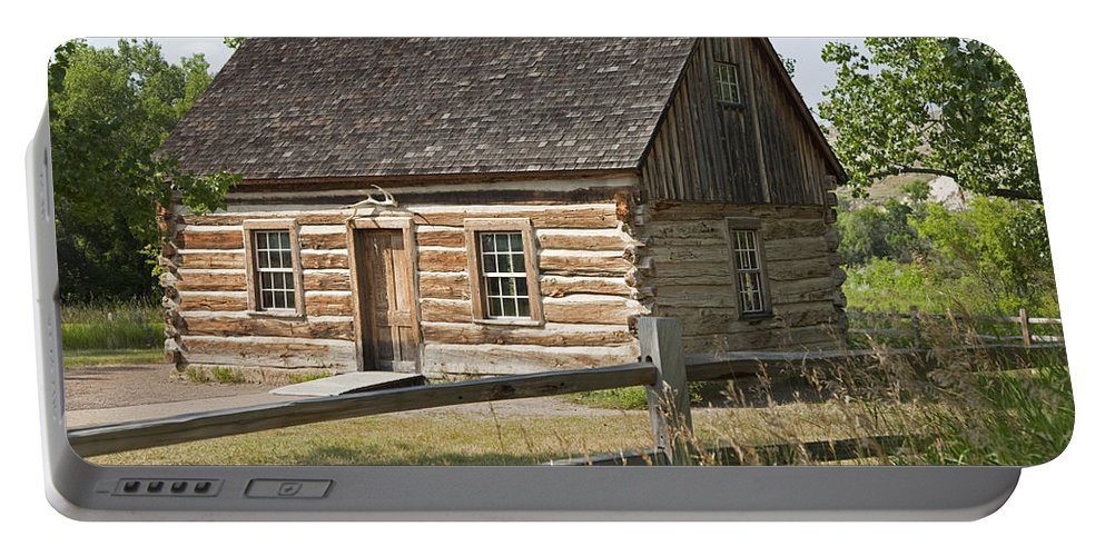 Past Portable Battery Charger featuring the photograph Teddy Roosevelt's Maltese Cross Log Cabin by John Stephens