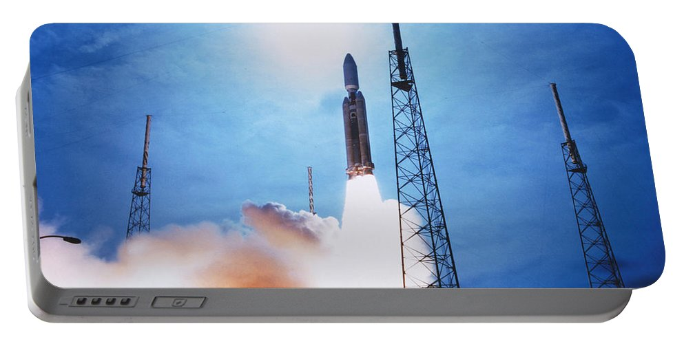 Transport Portable Battery Charger featuring the photograph Titan Iv Rocket by Science Source