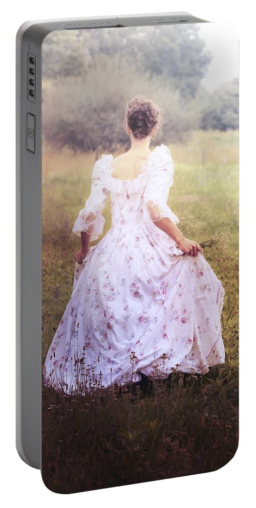 Female Portable Battery Charger featuring the photograph Woman In A Meadow by Joana Kruse