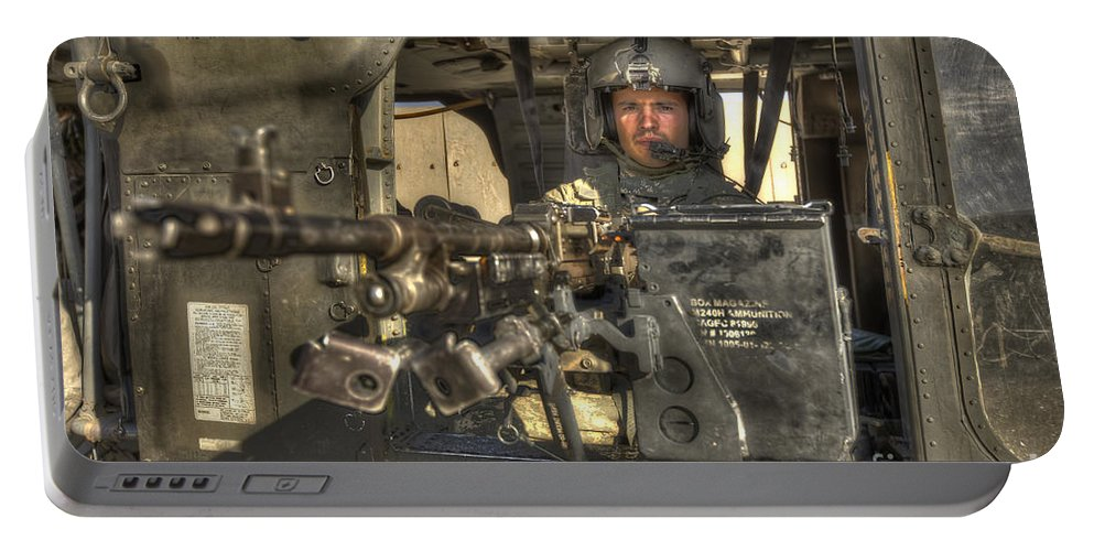 Aviation Portable Battery Charger featuring the photograph Hdr Image Of A Uh-60 Black Hawk Door by Terry Moore