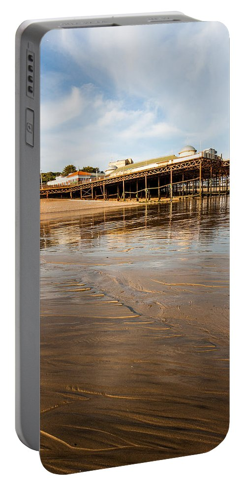 Beach Portable Battery Charger featuring the photograph Hastings Pier by Dawn OConnor