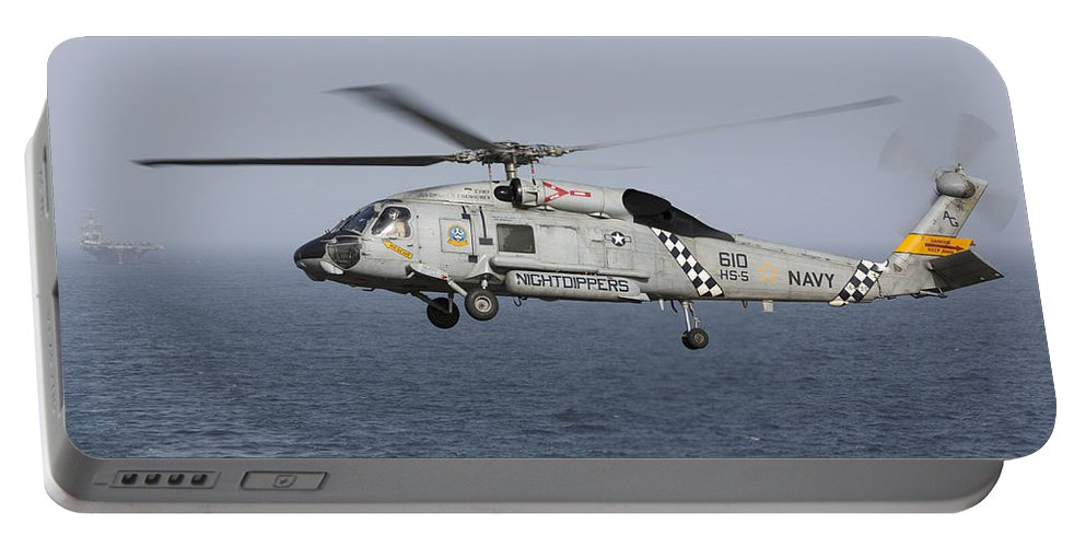 Arabian Sea Portable Battery Charger featuring the photograph A Sh-60j Seahawk During A Vertical by Gert Kromhout