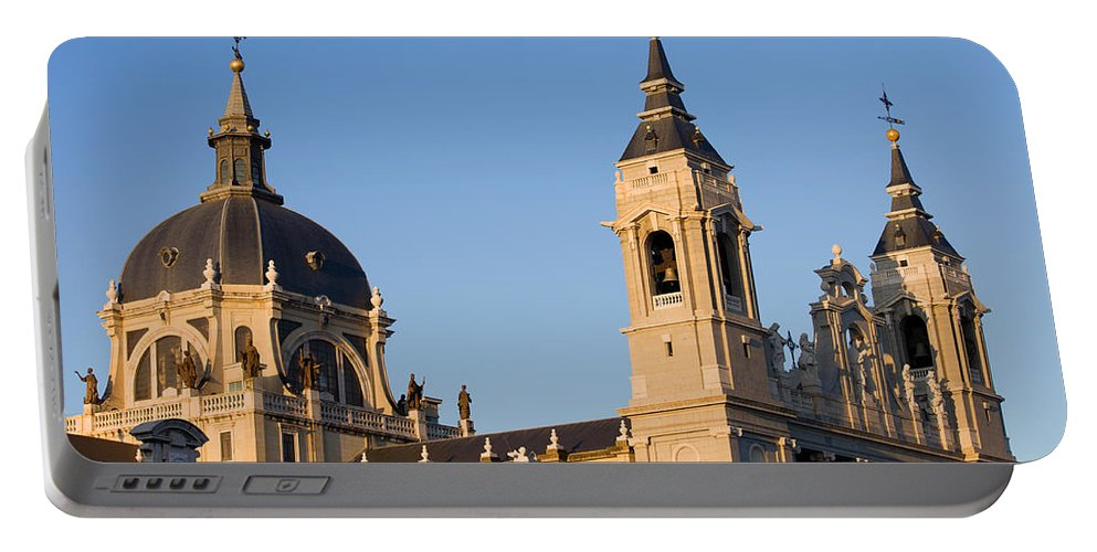 Madrid Portable Battery Charger featuring the photograph Almudena Cathedral In Madrid by Artur Bogacki
